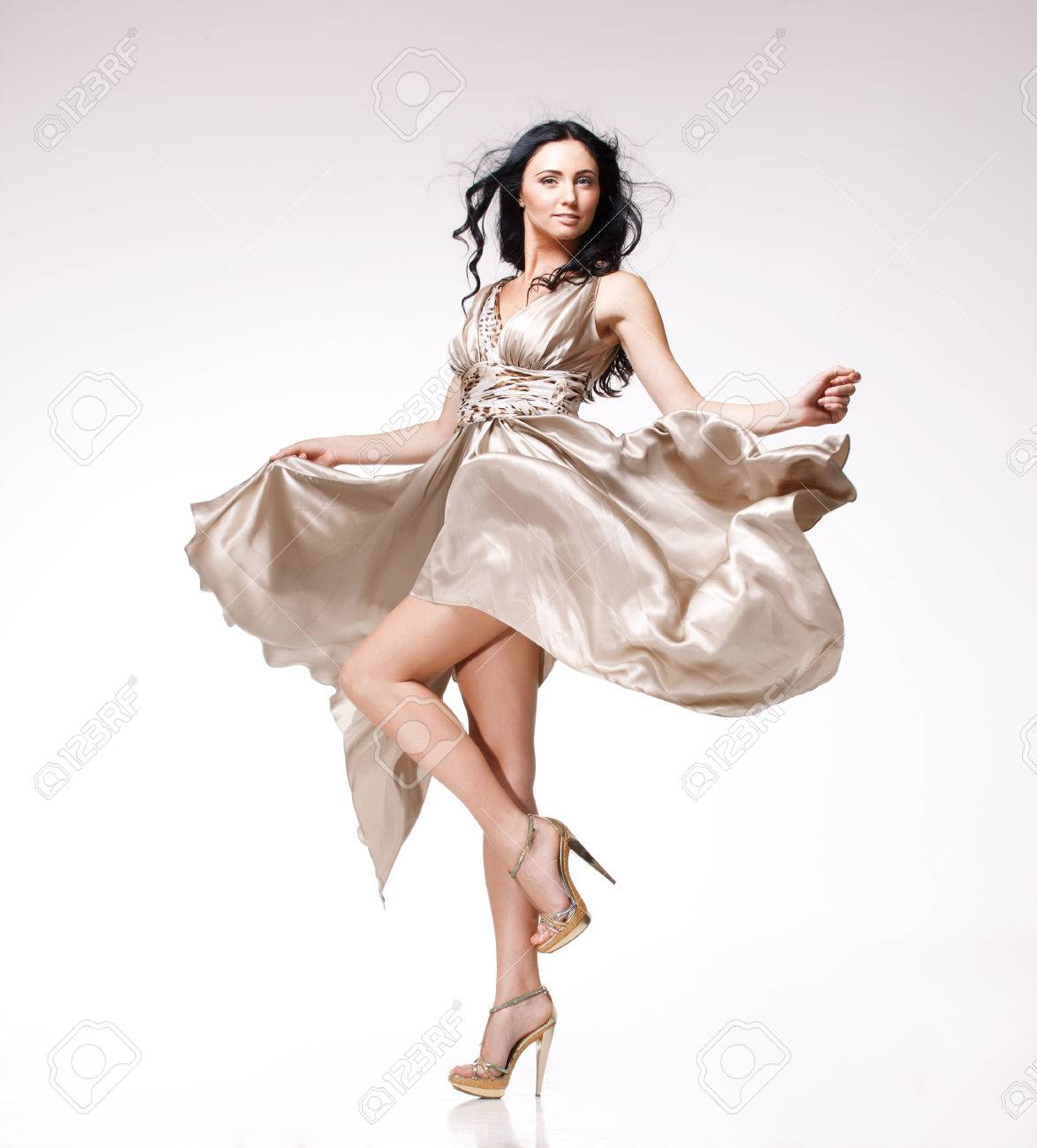 young beautiful caucasian brunette in gorgeous dress, motion shot Stock Photo - 23144518