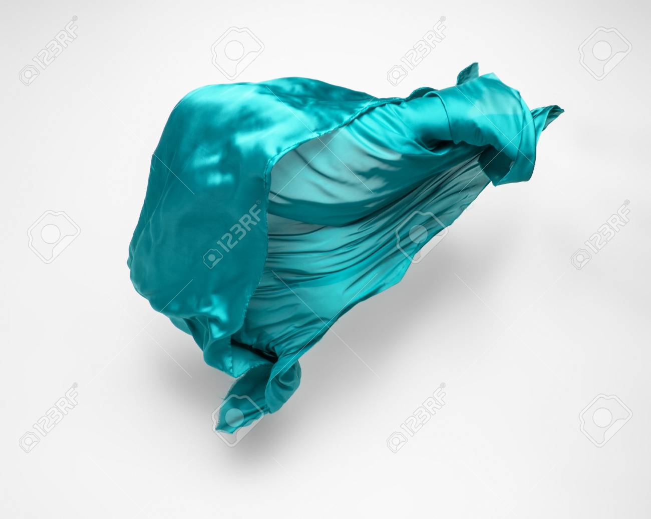 abstract piece of teal fabric flying, high-speed studio shot - 122260510