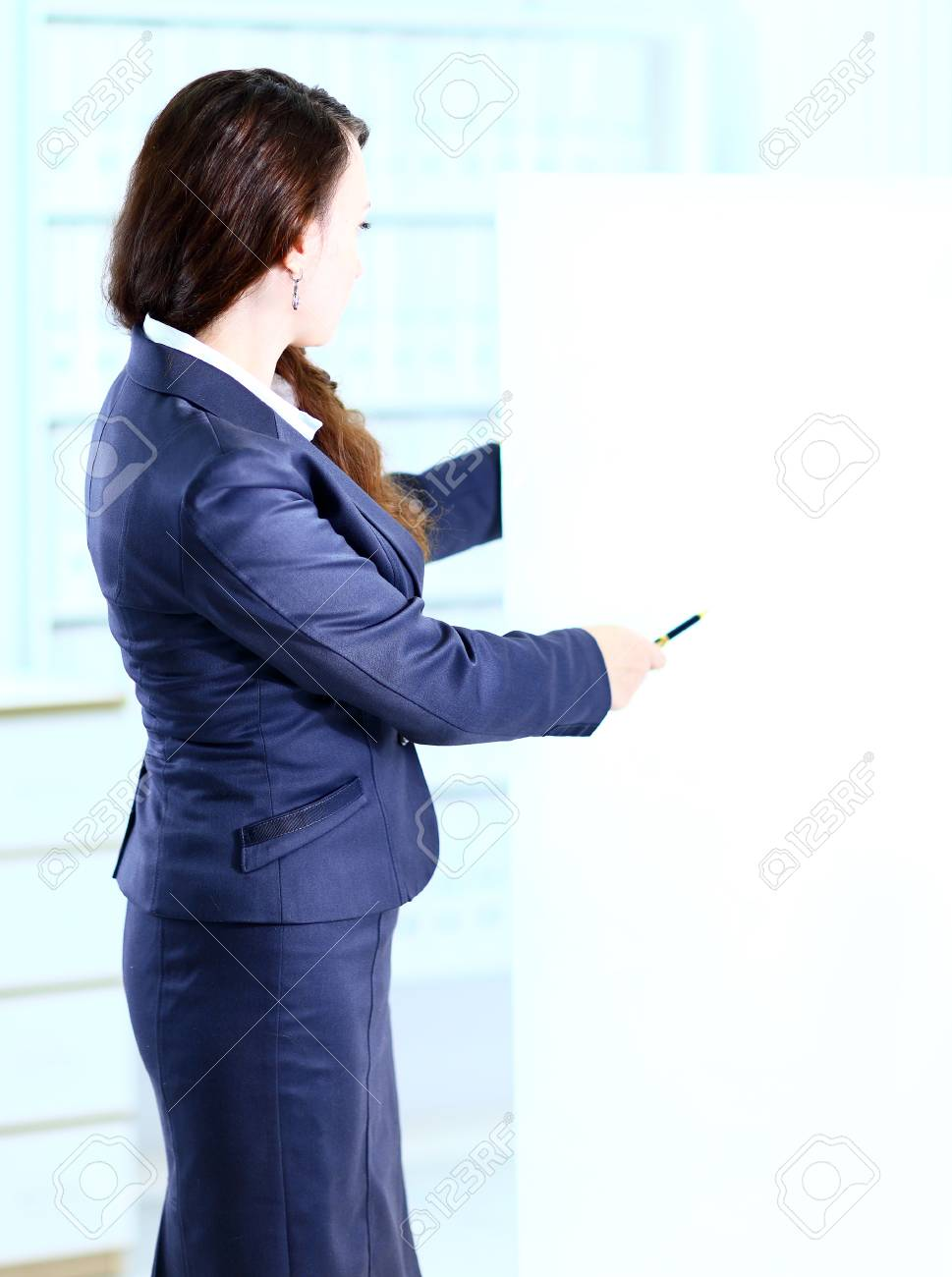 Happy smiling young business woman showing blank signboard Stock Photo - 24346814