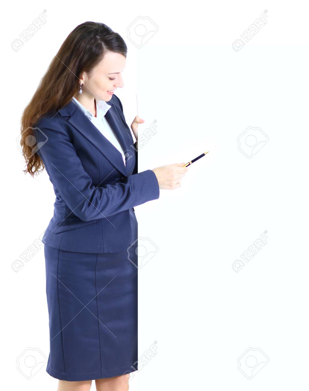 Happy smiling young business woman showing blank signboard, isolated on white background Stock Photo - 25395990