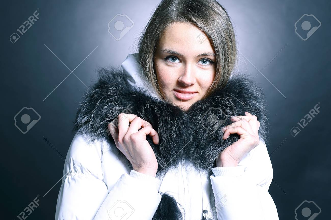 ca0c9e7933e26 portrait of beautiful young woman in winter jacket Stock Photo - 93198337