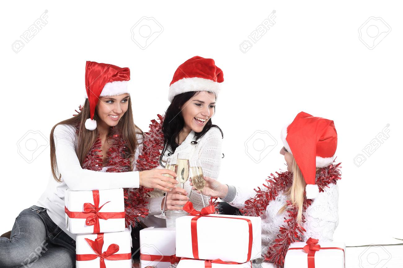 Three Young Women In Hats Of Santa Claus With Christmas Gifts Stock ...