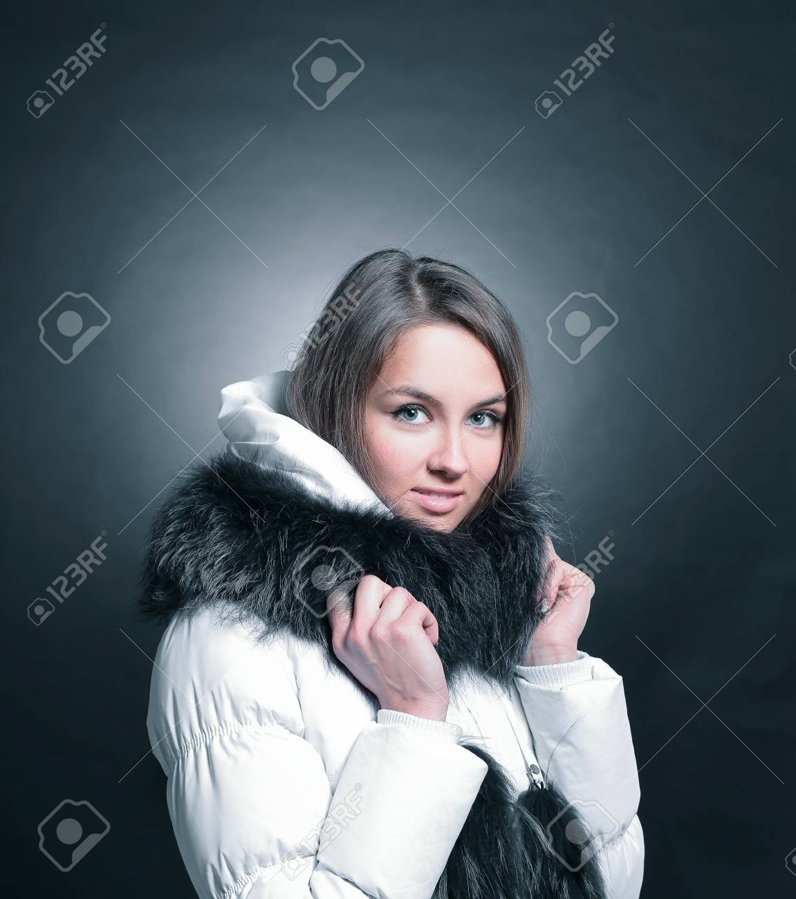 6cee59ad4af46 portrait of beautiful young woman in winter jacket Stock Photo - 97656548