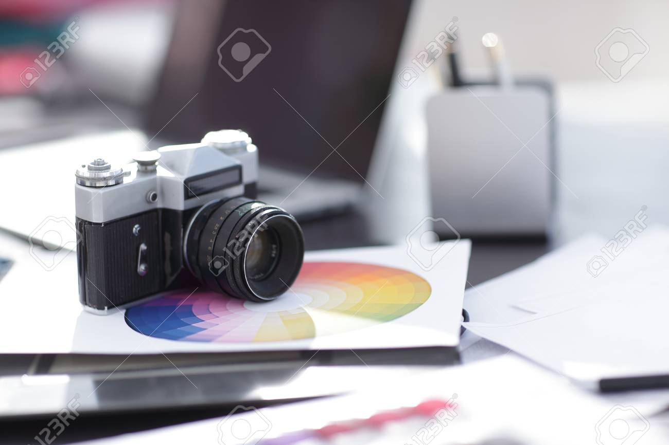 Old Retro Movie Camera 35mm On The Table By Modern Stock Photo