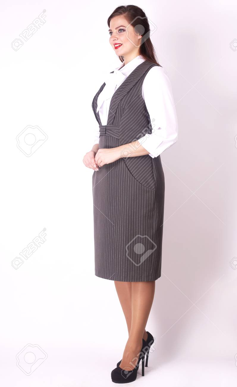 side view. stylish female model in business dress .plus size