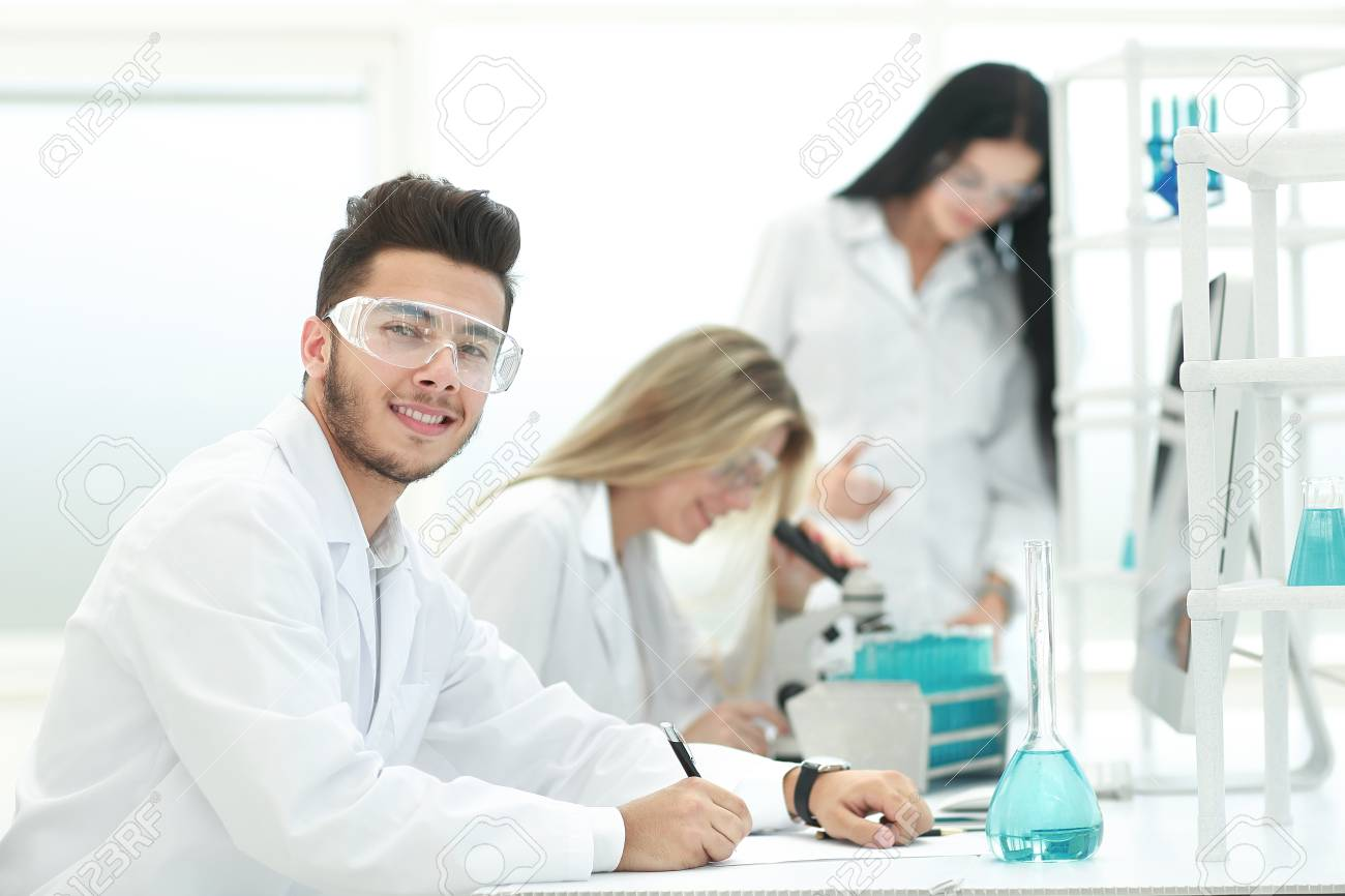 close up.young scientist sitting at his Desk in the laboratory - 120481109