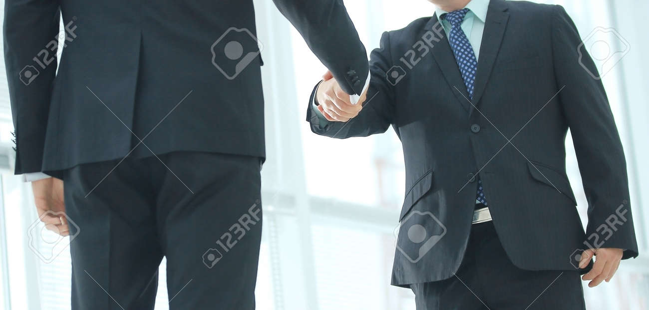 Closeup of handshake of two entrepreneurs wearing business suit - 126084540