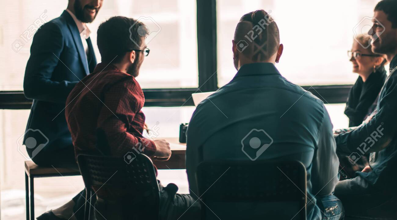 multinational business team brainstorms in the workplace in a mo - 128217726