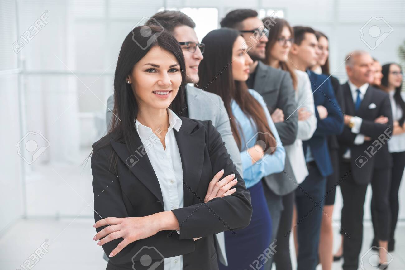 young business woman standing in front of her colleagues. the concept of teamwork - 143717013
