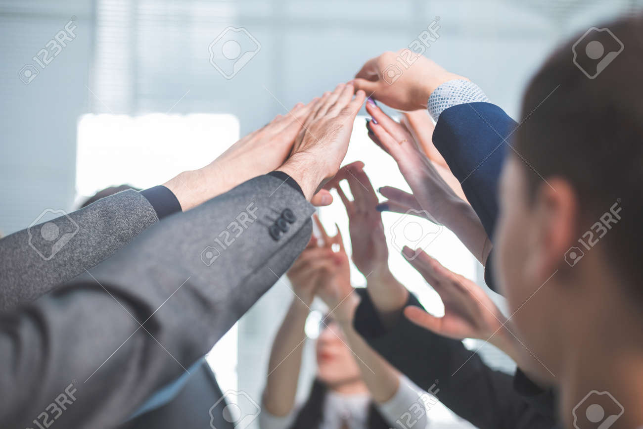 close up. a group of employees joining their palms - 144164240