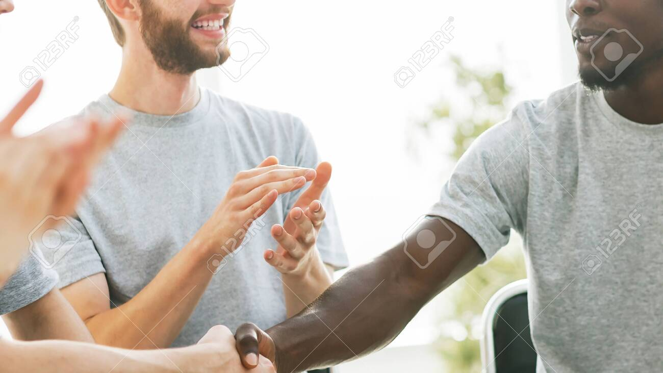 business training participants greeting each other with a handshake - 150874588