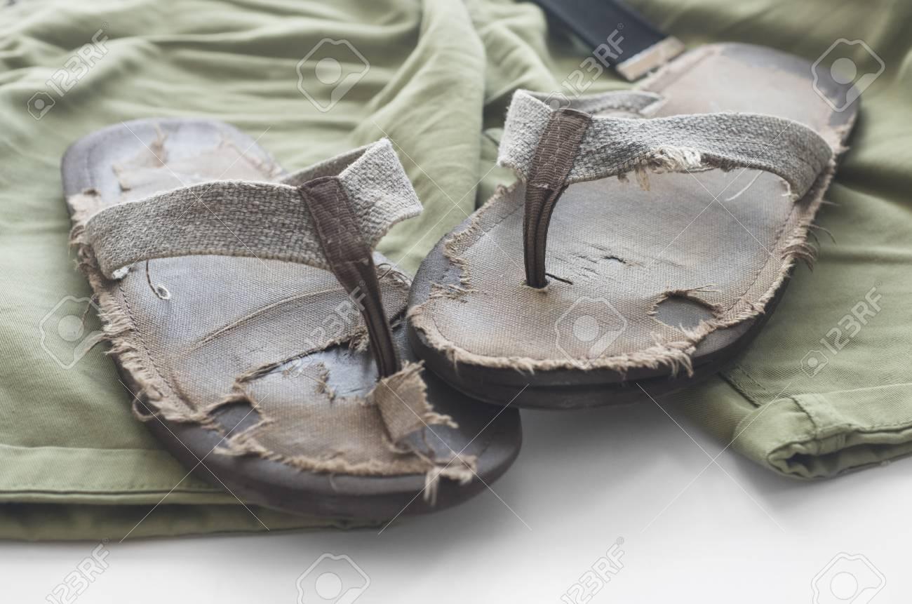 ad967cd702b Men s beach sandals on a green shorts. Stock Photo - 61838817