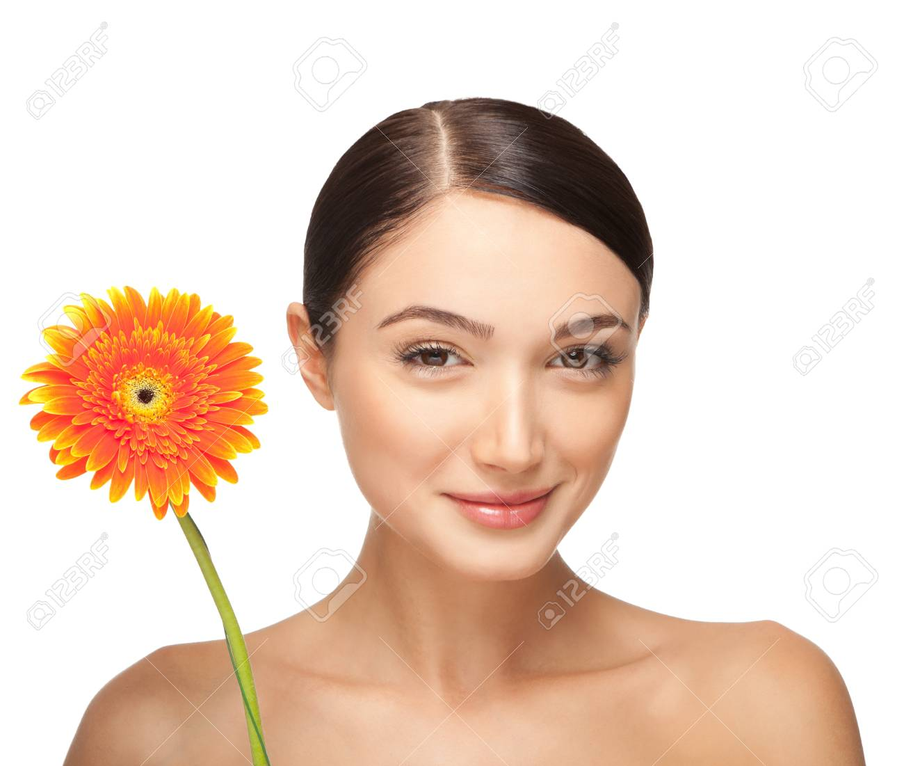 Portrait of beautiful smiling young woman with a flower. Taken in the studio. Stock Photo - 17344930
