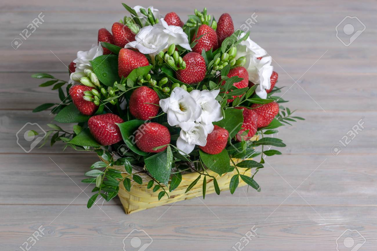 Bouquet From Flowers And Fruit. Ripe Strawberry And White Freesia ...