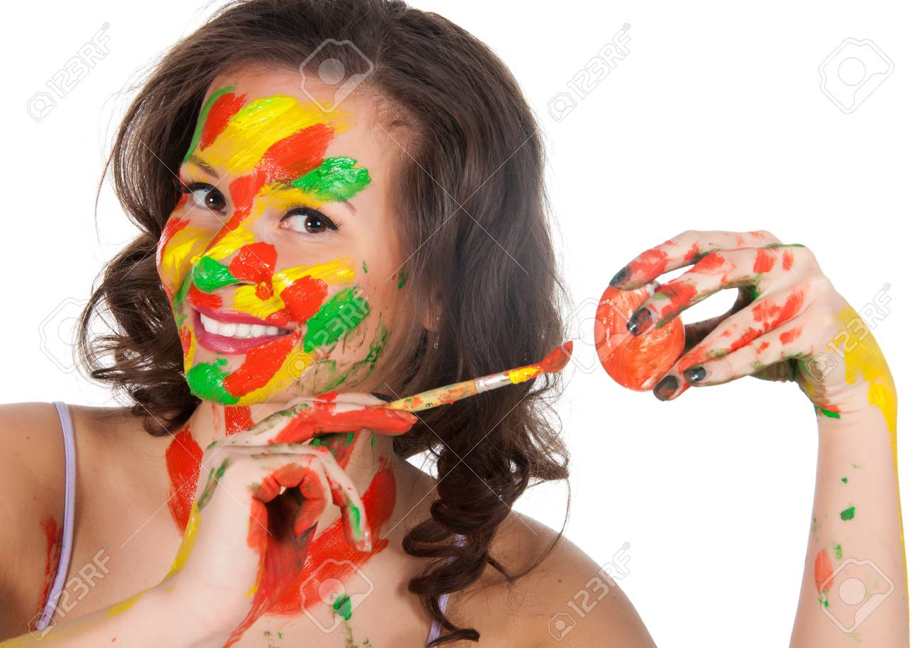 Happy young woman painting Easter eggs. Stock Photo - 23976278
