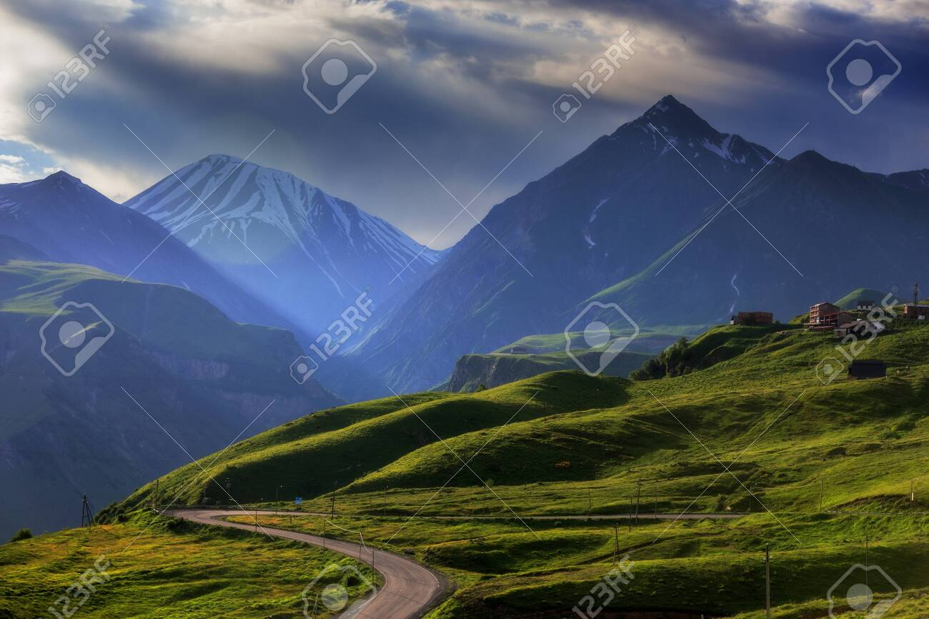 Mountain landscape at sunset time, with the rays of the sun. - 139024047