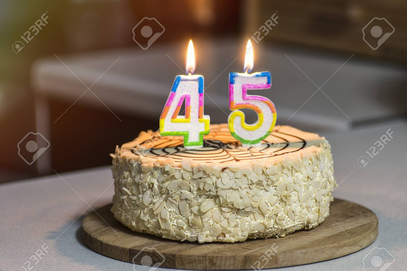 Birthday Cake Candles Burn In The Form Of Numbers 45 Stock Photo