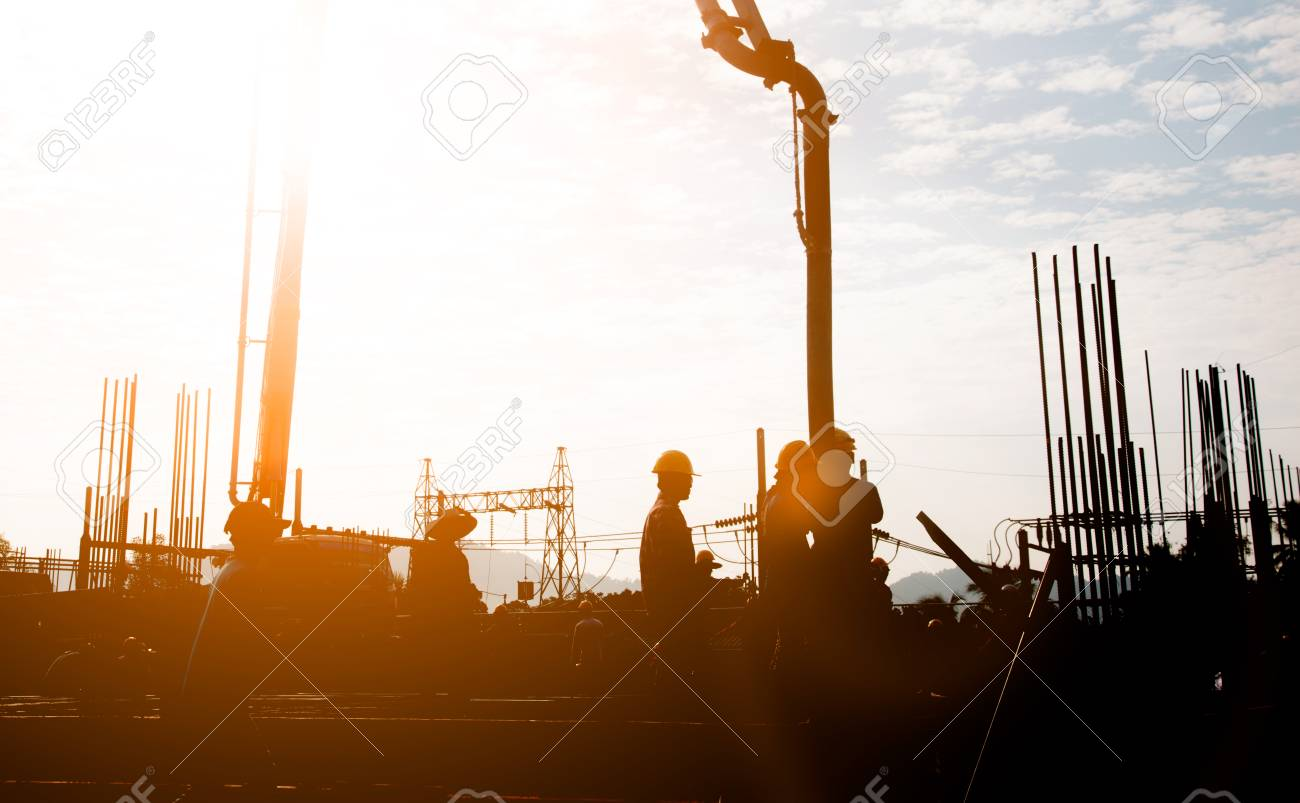 Silhouette construction industry team safely to work load concrete building according to set goal over blurred background sunset pastel for industry background. - 81958504