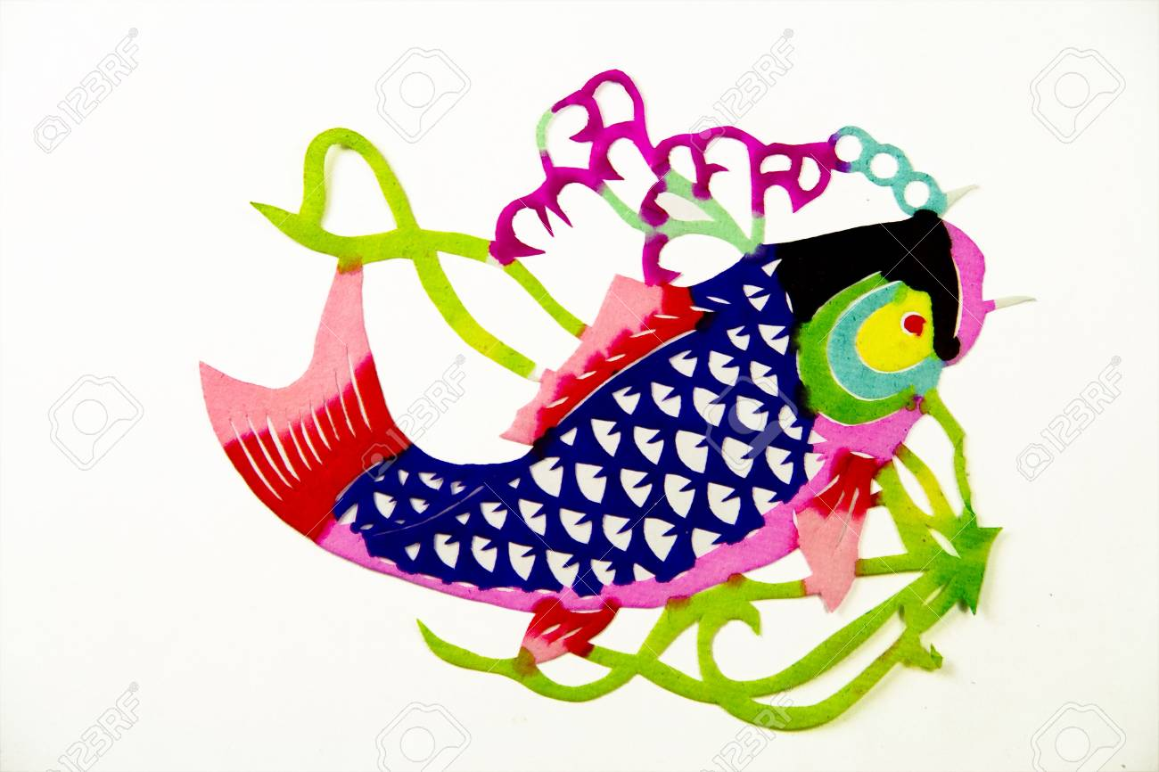 The traditional paper cut fish on the white Stock Photo - 2029143