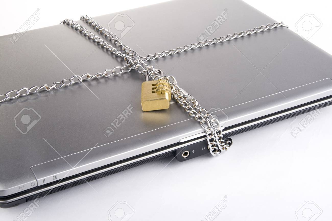 Laptop with chains and combination padlock isolated on white Stock Photo - 3565090