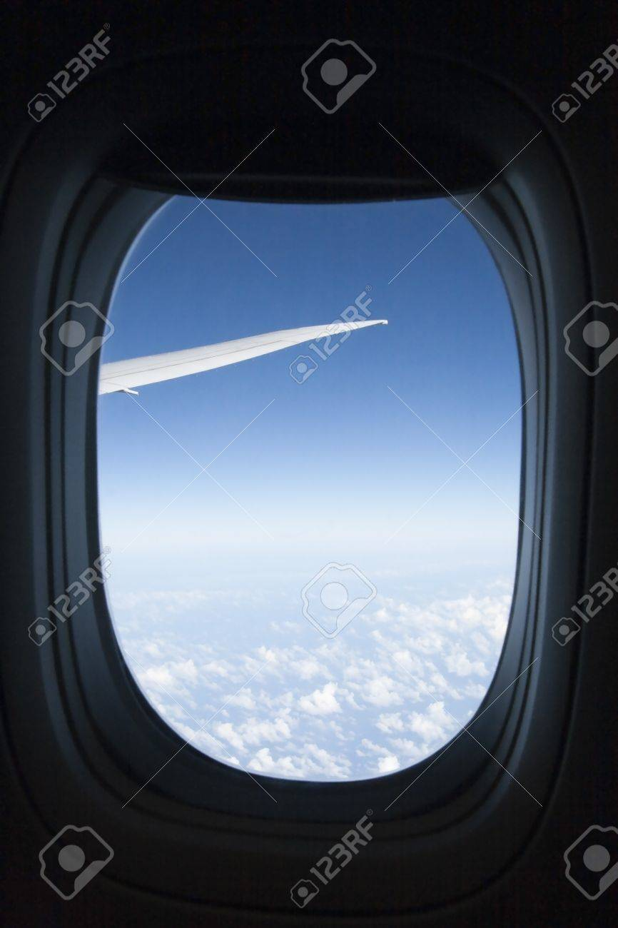 a view of clouds from an airplane window stock photo picture and