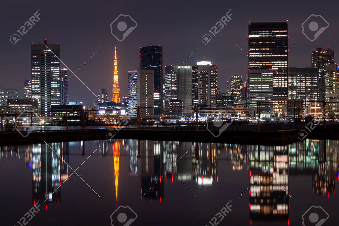 Night Tokyo Reflected on the Surface of the Water - 165179252