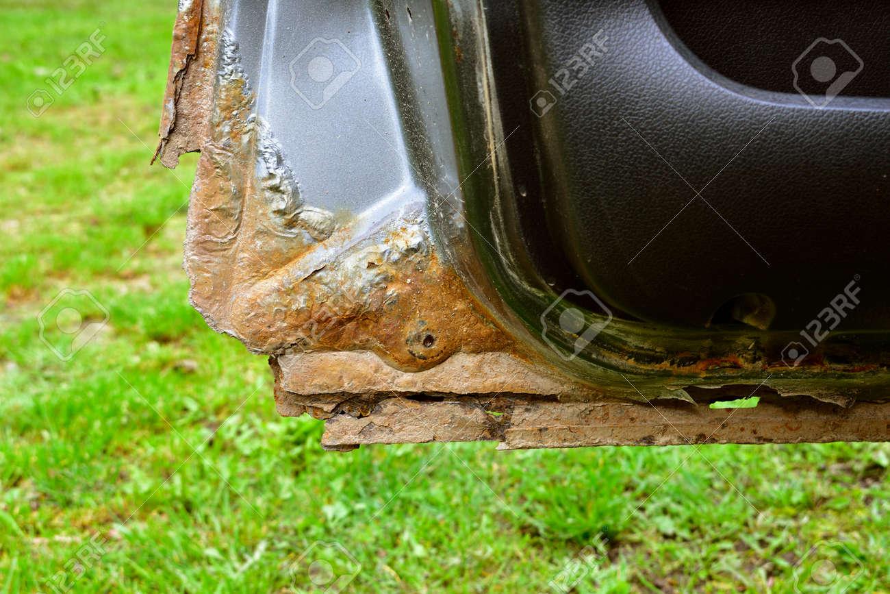very badly rust-damaged car door, inner side of the door - 155949189