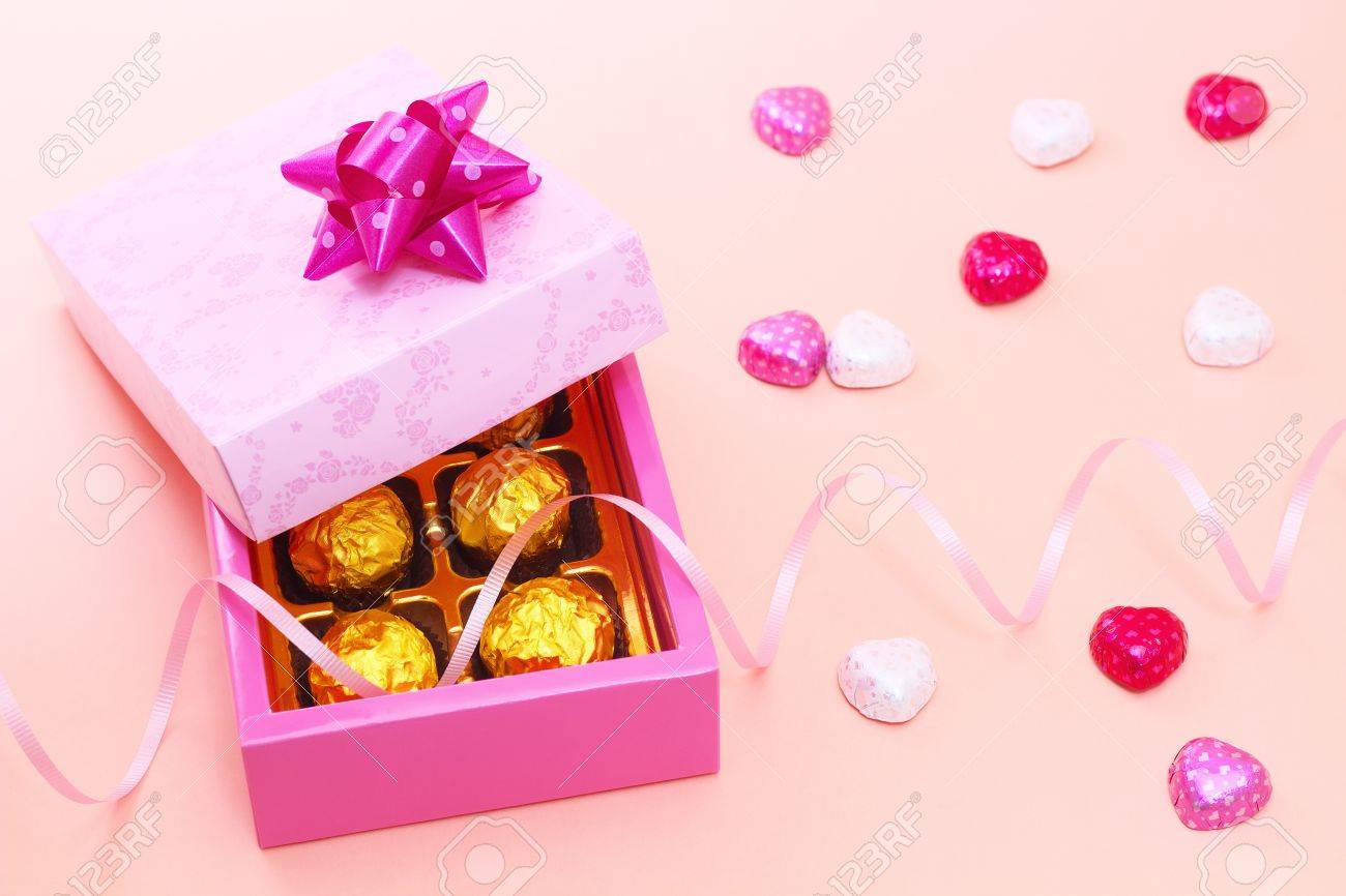 chocolates in a cute gift box with heart candies stock photo