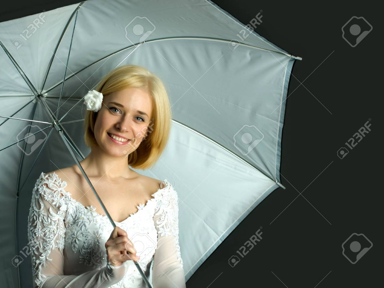 Portrait of young woman on black background with umbrella Stock Photo - 4637390