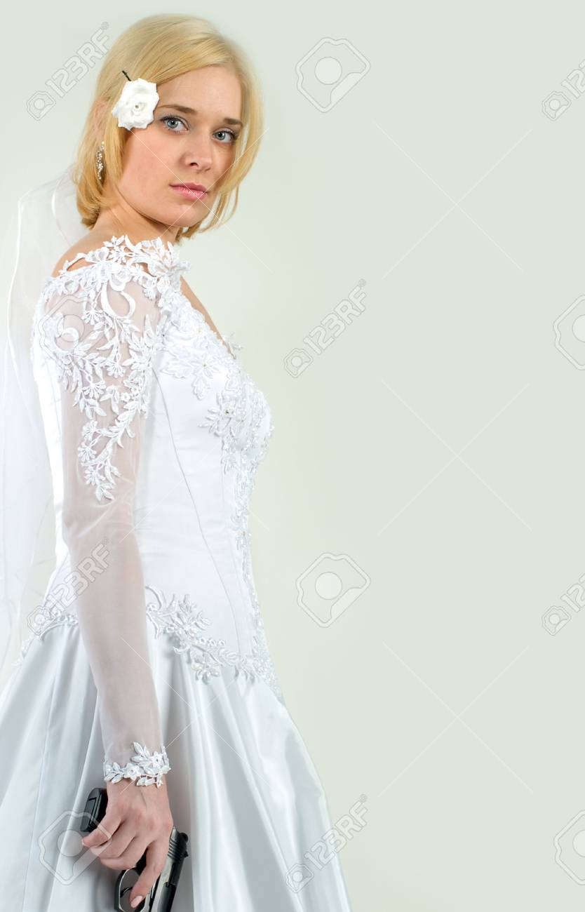 beauty young bride in white dress holding the gun Stock Photo - 4666029