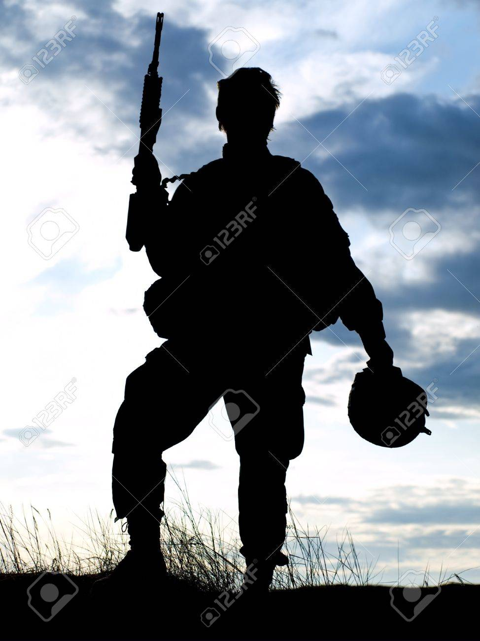Silhouette of US soldier with rifle against a sunset Stock Photo - 9965768