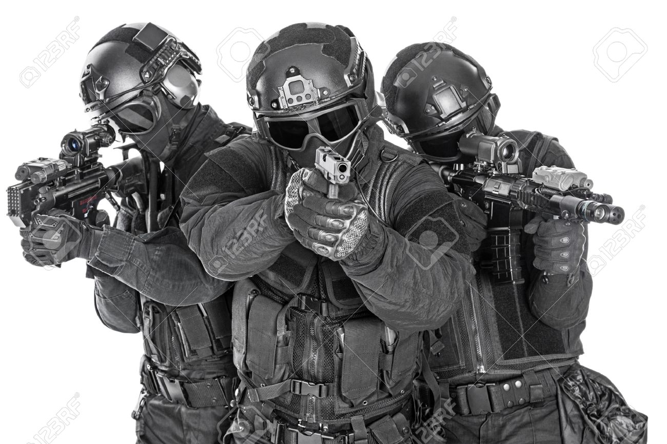 Spec ops police officers SWAT in black uniform and face mask