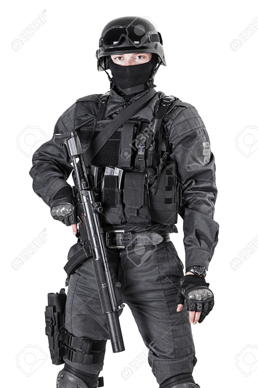 Spec ops police officer SWAT in black uniform studio shot