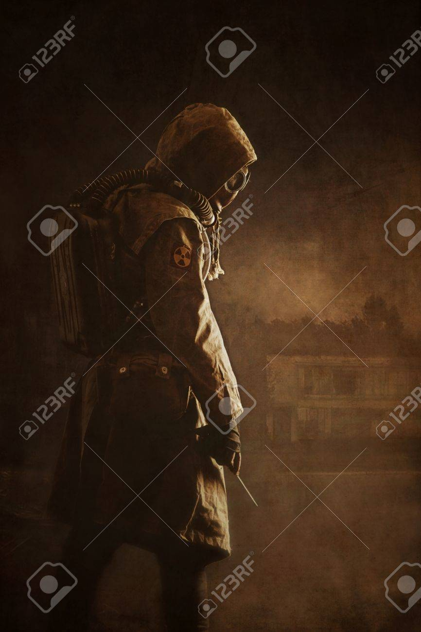 Post apocalypse. Sole survivor in tatters and gas mask on the ruins of the destroyed city - 50904303