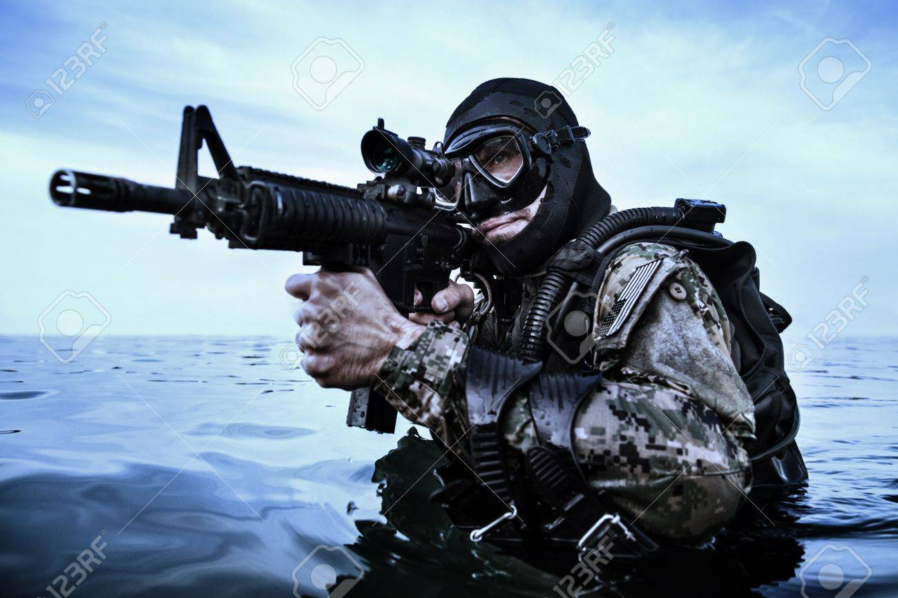 Navy SEAL frogman with complete diving gear and weapons in the