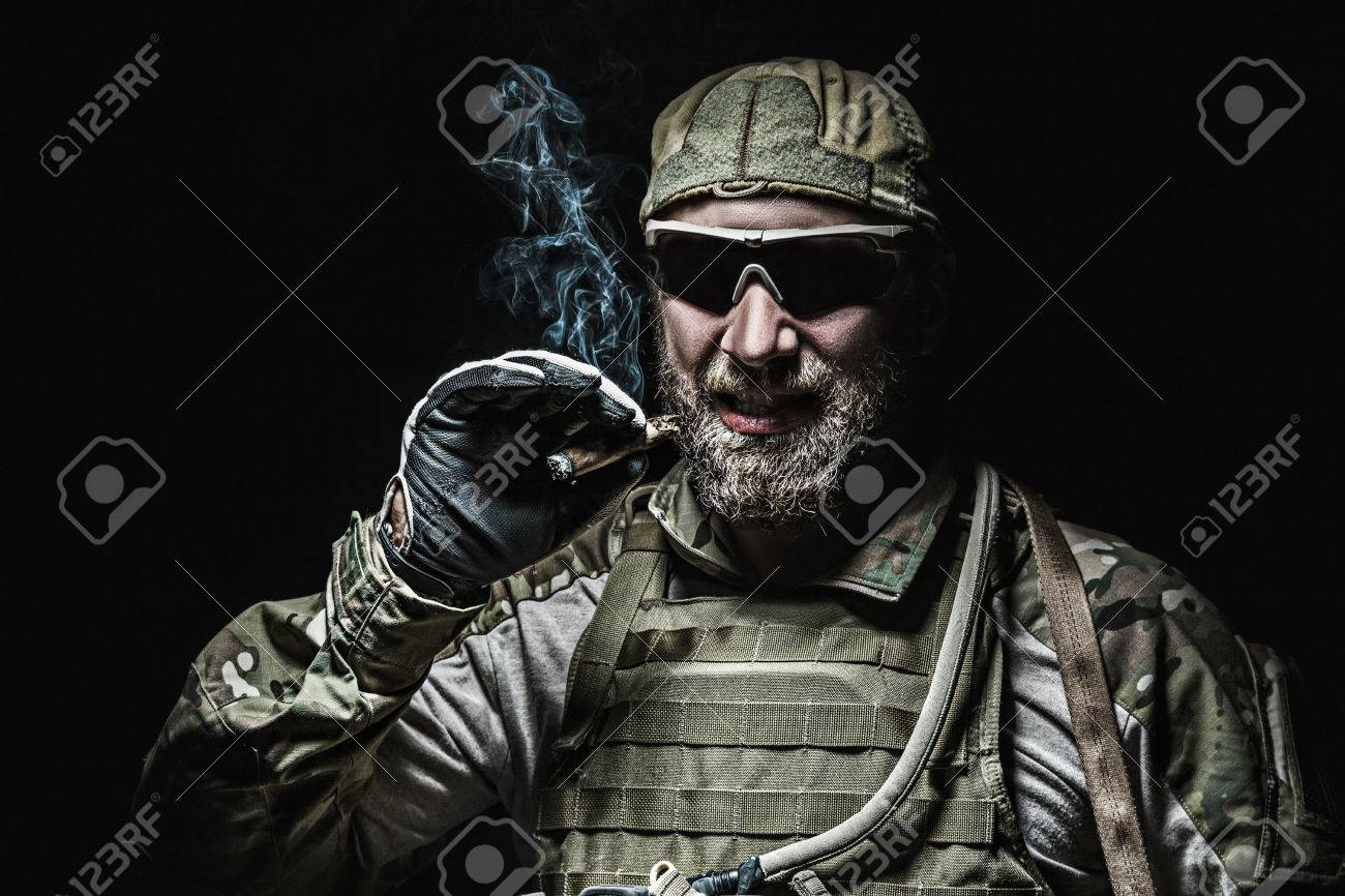 Green Berets US Army Special Forces Group soldier smoking - 53557544