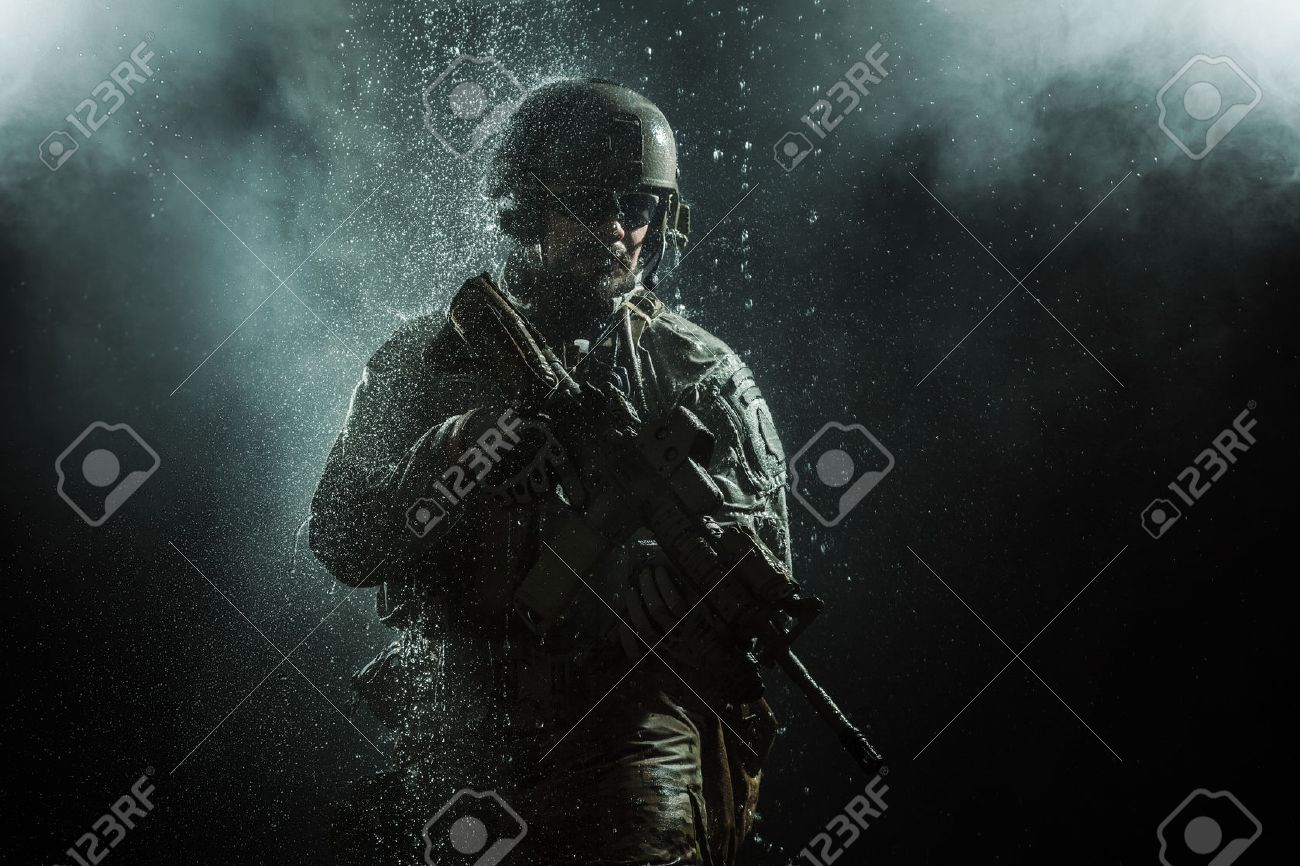 Green Berets US Army Special Forces Group soldier in the rain - 53558366