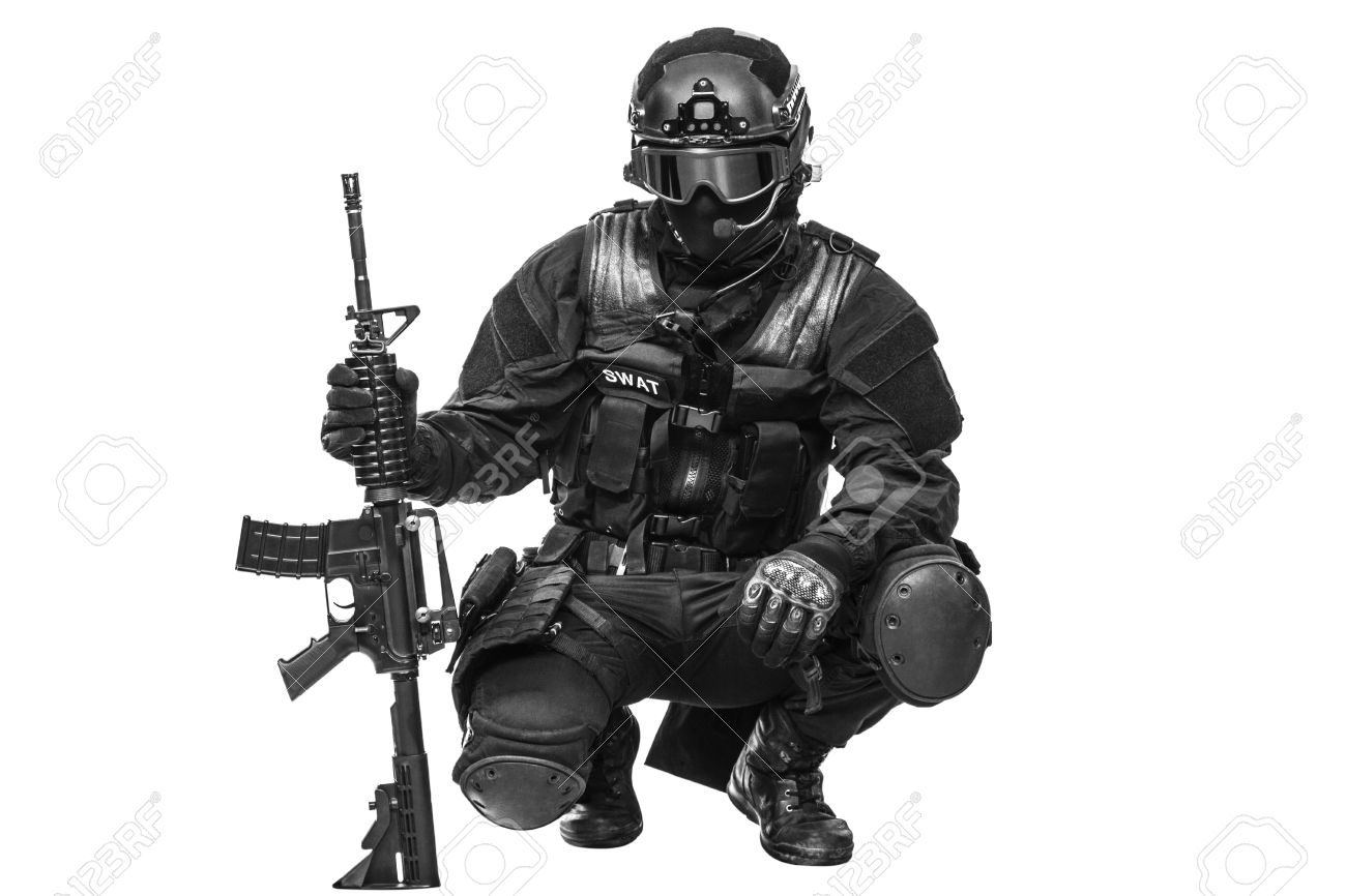 Spec ops police officer SWAT in black uniform and face mask studio