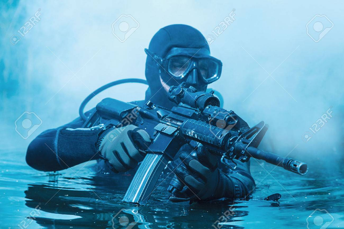 Navy SEAL frogman with complete diving gear and weapons in the water - 70000930