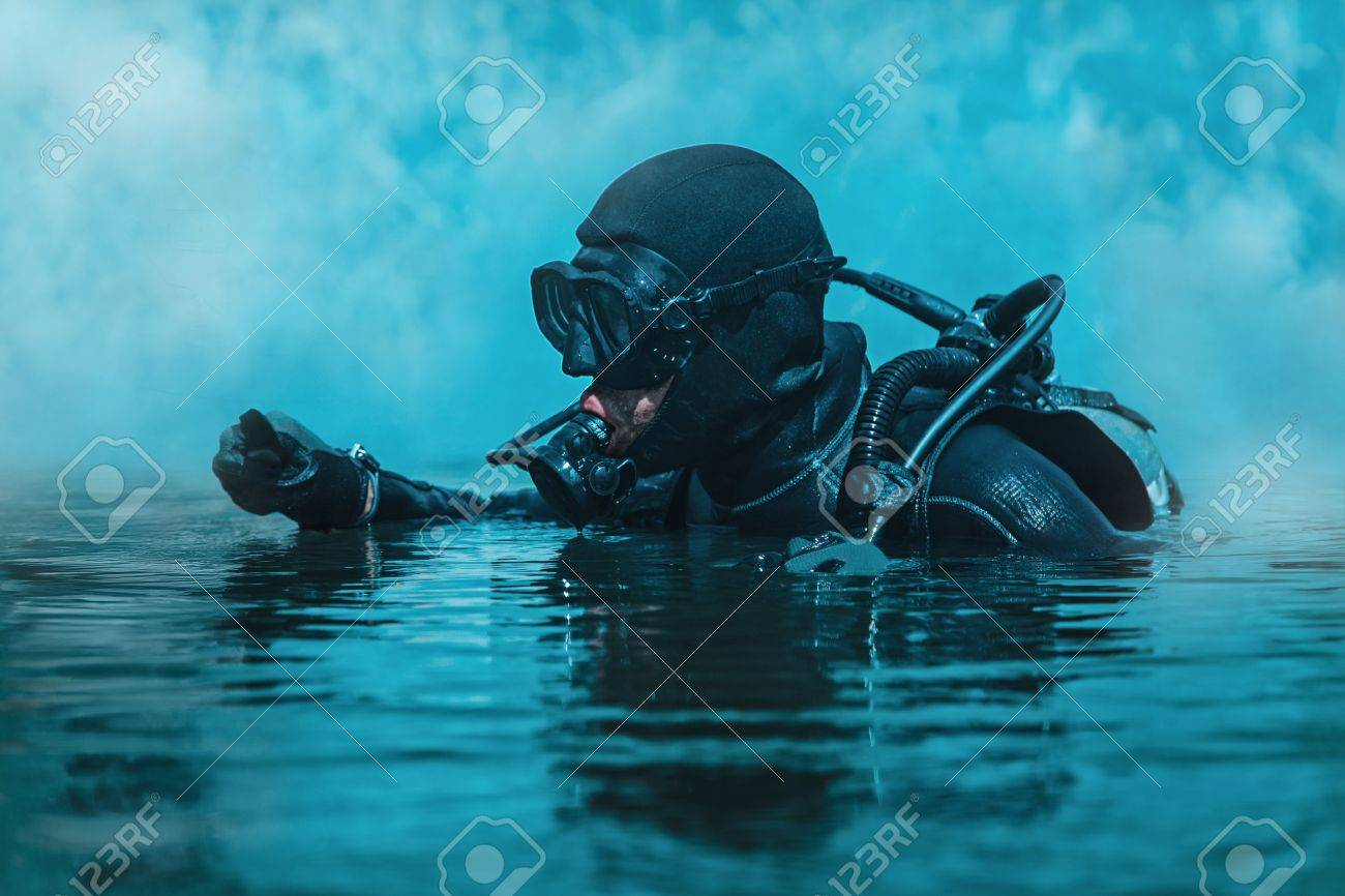 Navy SEAL frogman with complete diving gear and weapons in the water - 70000932