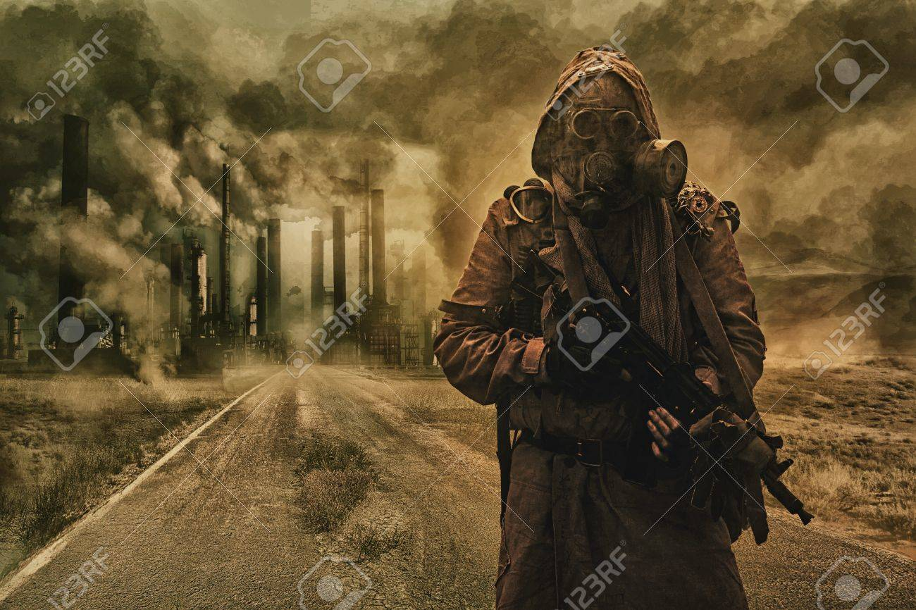 Post-apocalyptic air pollution. Survivor in tatters and gas mask on the background of pipes on abandoned road. Nature protection concept - 75873764