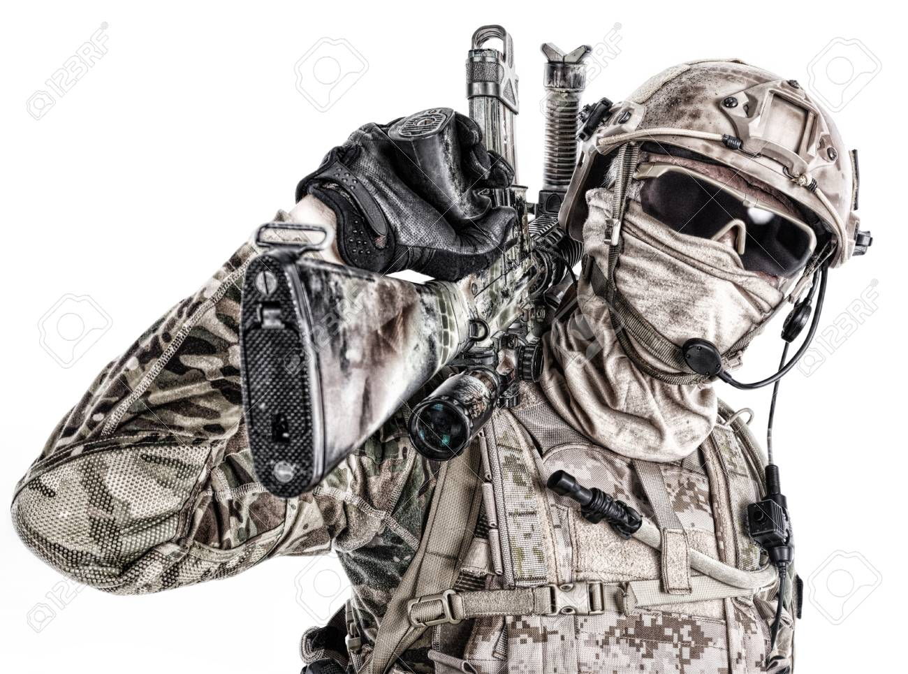 Half length low angle studio shot of special forces soldier in