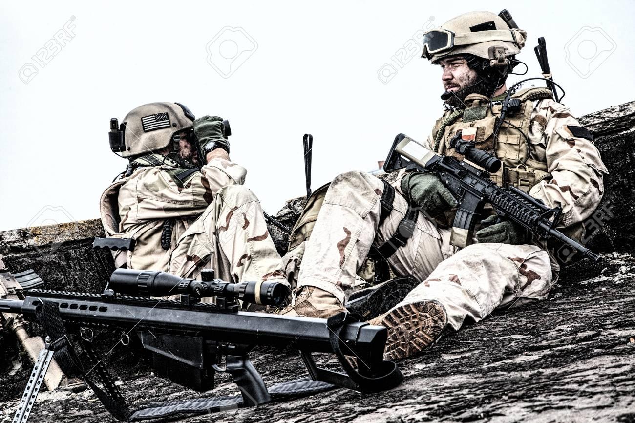U S  Navy SEAL infantrymen, commando marksman in battle uniform,