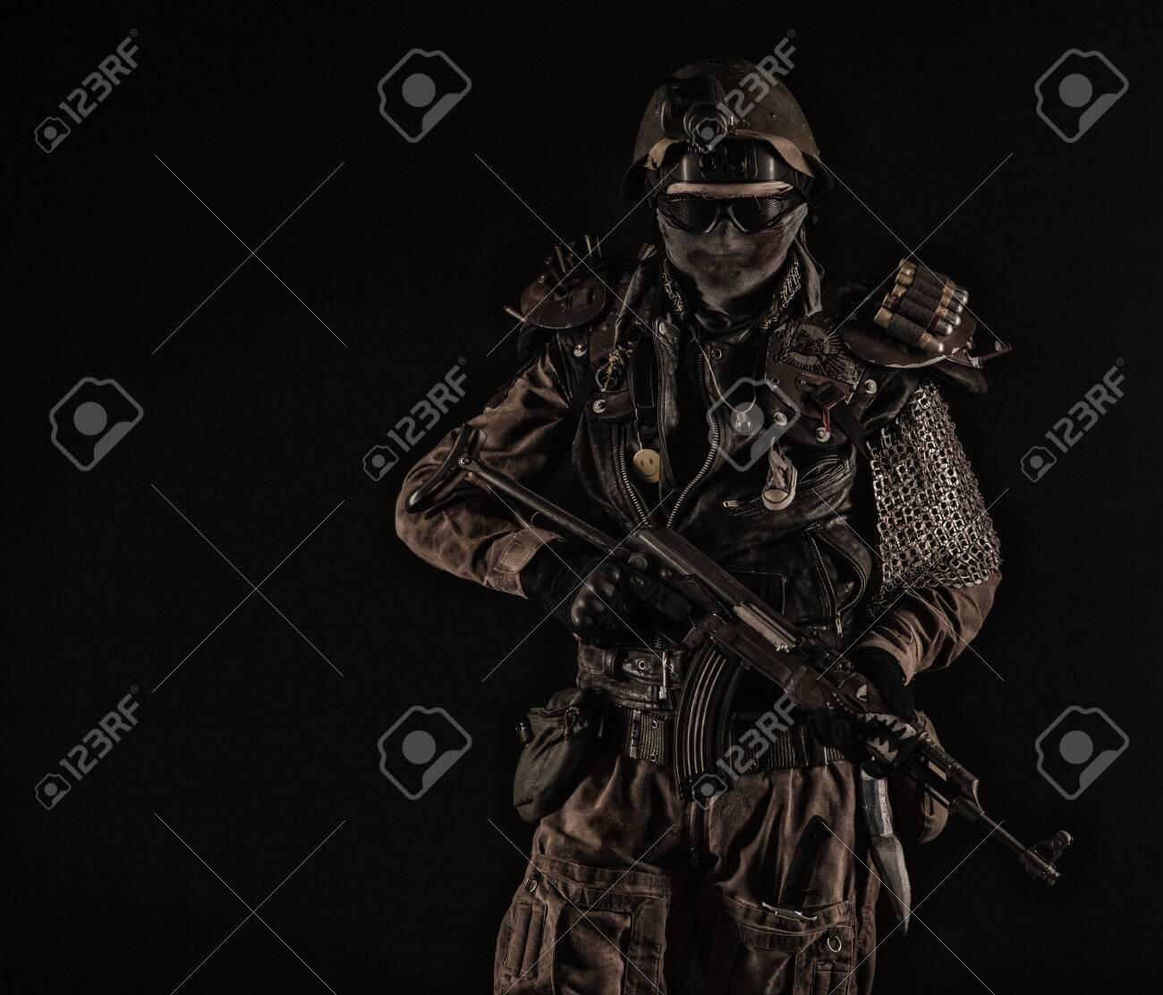 Nuclear post apocalypse life after doomsday concept. Grimy survivor with homemade weapons. Studio portrait - 147184127