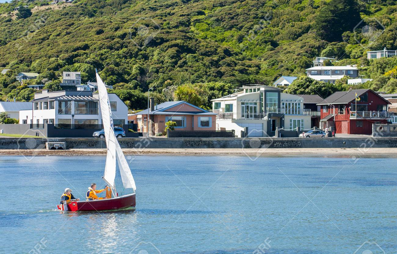 P class background image - Stock Photo Two Men Sailing In A P Class Yacht Close To Shore With Houses In The Background Location Is Plimmerton Porirua
