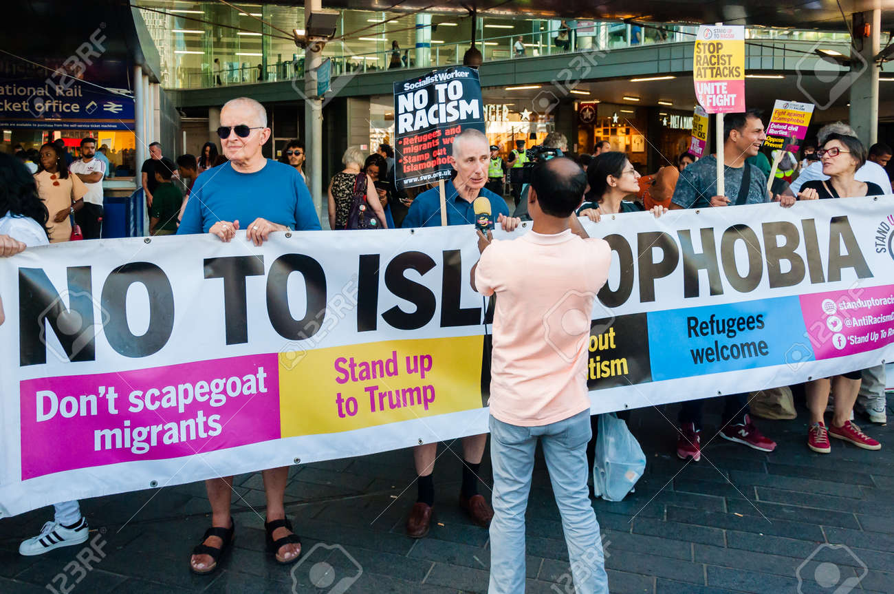 Protesters holding placards & posters at the March Against Racism national demonstration, Stratford, London, UK, in protest of the dramatic rise of acid race related attacks. - 153844908