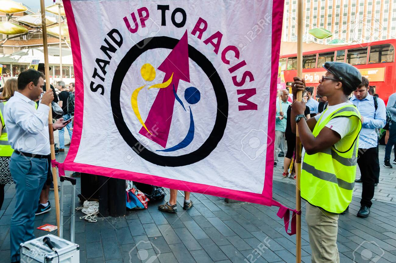 Protesters holding placards & posters at the March Against Racism national demonstration, Stratford, London, UK, in protest of the dramatic rise of acid race related attacks. - 153844913