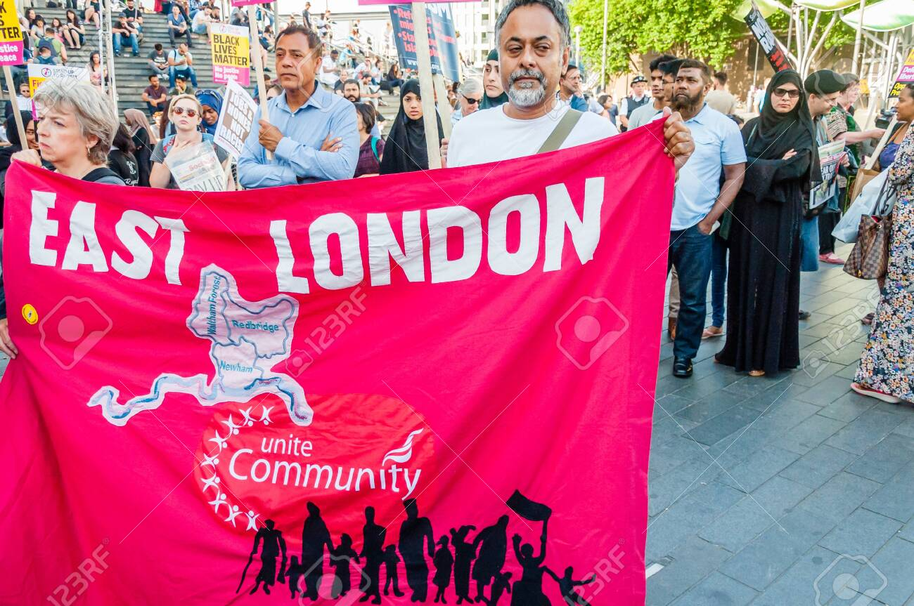 Protesters holding placards & posters at the March Against Racism national demonstration, Stratford, London, UK, in protest of the dramatic rise of acid race related attacks. - 153844917