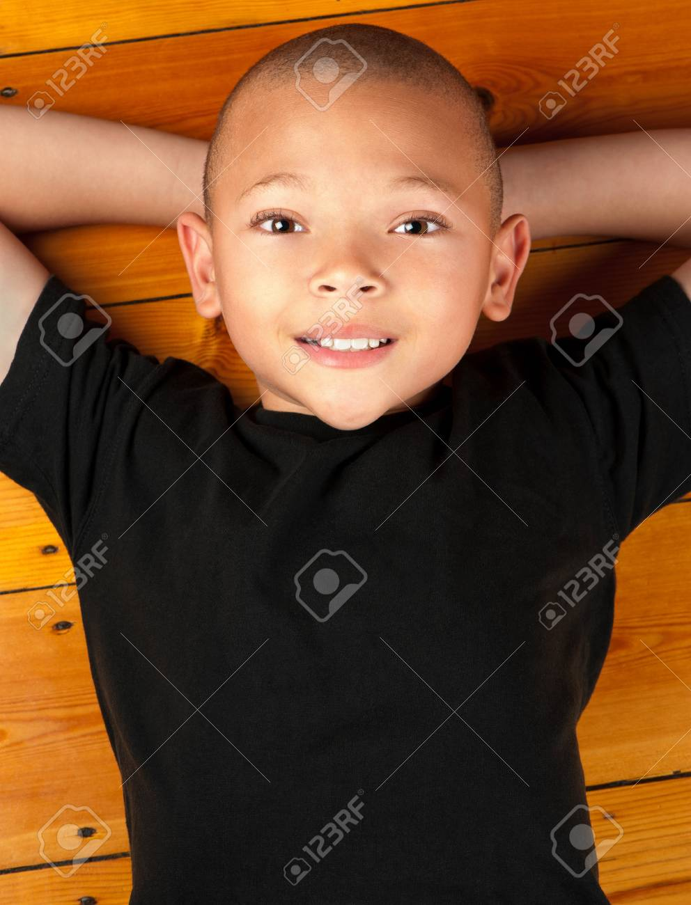 A young boy lies on his back and is content with life. Stock Photo - 14390317