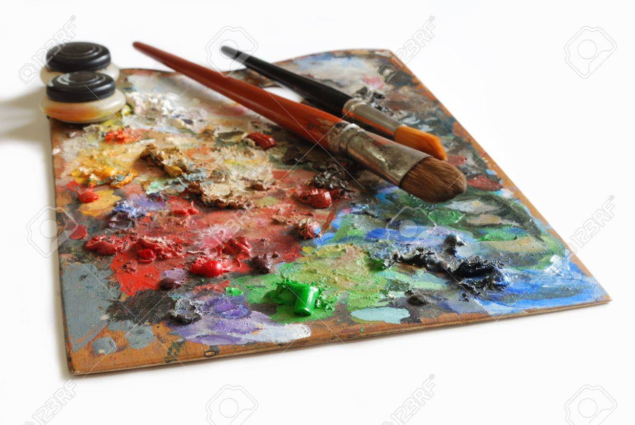 Artistic color pallete and brushes on white background Stock Photo - 10347752